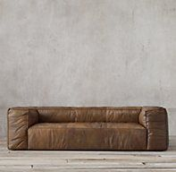 RH's Fulham Leather Sofa:Tailored with reverse seaming that exposes its raw edges, our supple leather sofa displays the casual, well-worn hand of a vintage flight jacket. Its oversized profile, foursquare lines and deeply padded arms and back offer seating with exceptional comfort and relaxed style.