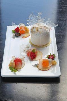 Pavlova with compressed seasonal fruit.