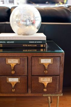 Old library drawers can be repurposed into a coffee table with a mirrored top…