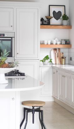 Bright white kitchen and Scandi-inspired living and dining area home tour   The Green Eyed Girl
