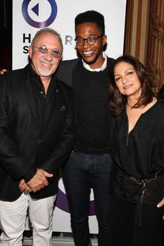 #AWXII - Advertising Week: (L-R) Musician Emilio Estefan, Associate Editor at Fast Company KC Ifeanyi, and Musician Gloria Estefan pose at the Get On Your Feet!