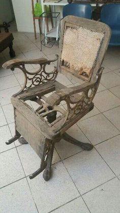 Carcaça de cadeira de barbeiro por restaurar