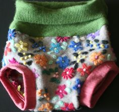 Looking for the functional, yet cute diaper cover? This 100% upcycled wool cover is perfect for pictures and keeping leaks at bay! You will not see this diaper cover as it is one of a kind~ The fold over waist will allow for growth and a longer fit. Wool cover keep baby dry when paired over a...