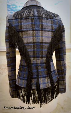 Do you like wearing unusual items ? This lovely smart jacket is definitely not a common elegant wardrobe garment. The generous fringe around the