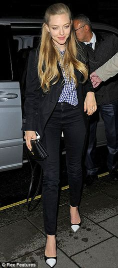 It goes with everything: Amanda has certainly been giving the coat an outing in London...