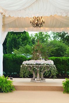 Entrance tent to Wedding. Flowers by Romance of Flowers. Photo by Kakki Morrison.