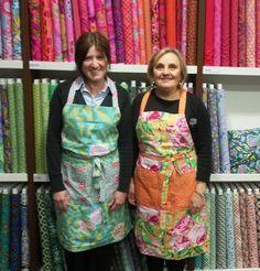Julie & Jayne wearing aprons in Kaffe Fassett fabrics