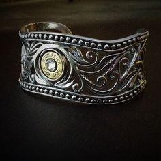 This bullet bracelet features detailed filigree designed cuts in an oxidized silver beaded fashion on this unique piece of jewelry. Prepare to get some great compliments as the bullet head displays for a great conversation. Genuine .925 solid sterling silver, great weight and adjustable thick band, fits most wrists.