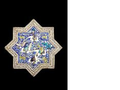 A large Qajar underglaze-painted pottery tile in the form of a star