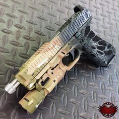 "gunzpr0nz: "" Custom half and half Glock from Valkyrie Combat. """