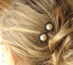 Victorian style hair pins. For a touch of elegance.