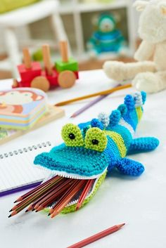 I'm not much into amigurumi, but this pencil-holder croc is cute and clever. Free pattern once you register on site. http://www.letsknit.co.uk/images/content/pattern-download/Mister_Snaps_by_Irene_Strange.pdf