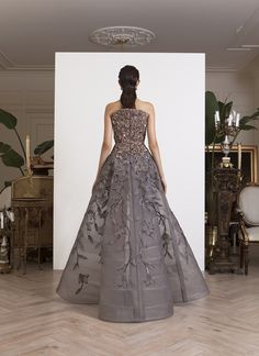 Greige and gray hand-sequined, high back strapless gown, with organza flowers, on tulle