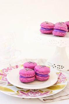Lavender Macarons ... These macarons are fun, colorful, and elegant.  They are lavender macarons filled with a pretty purple basic buttercream.  I dyed the macarons pink to add an extra girly touch.  To get the lavender flavor, I topped the macarons shells with small lavender buds that I purchased them from Williams and Sonoma.