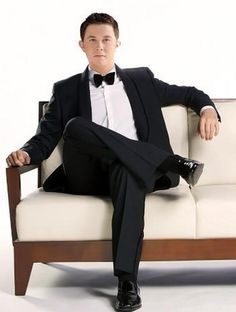 McCreery......Scotty McCreery Lord have mercy on me!!!! (I think I may have just died and gone to hunk heaven!)