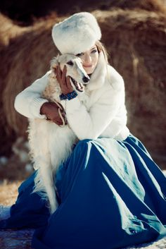 A lady with her beloved borzoi.
