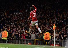 Anders Herrera leaps in the air after making no mistake from the penalty spot to put his side 4-1 up against Midtjylland