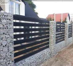 gabion fence with timber rails