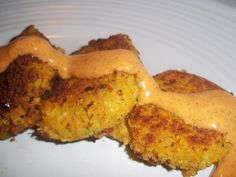 Chickpea and butternut cakes. Probably the best vegan recipe I've ever made. Made a sauce of 1:2 siracha and sweet chili.