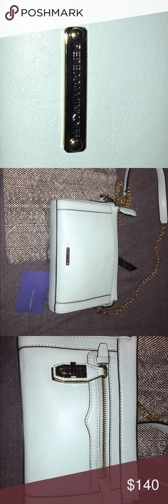 Rebecca Minkoff Over the shoulder Rebecca Minkoff bag in a light mint color with removable gold chain. Never been worn.. comes with original paper stuffing. Can either be worn as a clutch or over the shoulder.Comes with original Rebecca minkoff dust baggy. Rebecca Minkoff Bags Shoulder Bags