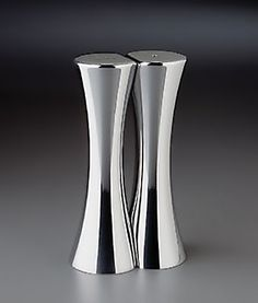 Nambe  Salt and Pepper Shakers as seen in Crooked brains, I love these sleek, elegant salt and peps !