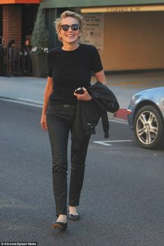 Hello there: The actress appeared to be in good spirits smiling as she crossed the street