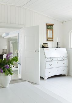 Love the white painted wood floors!