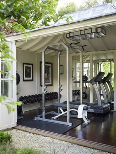 Outdoor garage gym with really cool door for feeling like you're working out outside