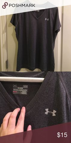 Under Armour dark grey v-neck size large Under Armour dark grey v-neck size large. Worn once. No holds or trades. ❤️❤️❤️ Under Armour Tops Tees - Short Sleeve