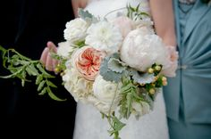 white bouquet with soft hints of color, we can make the orange warmer