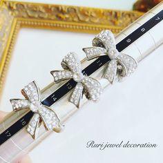 【スワロフスキー】清楚☆シンプル上品なクリスタルリボンのリング