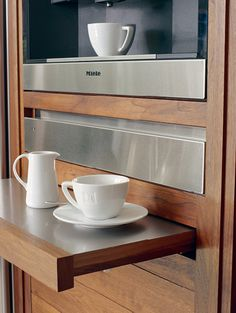 Pop-out stainless steel shelf