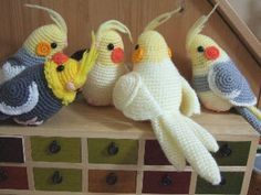 Crochet Cockatiels ~ i know i wouldn't have the patience for crochet, so i'd make felt/fabric versions...very cute!