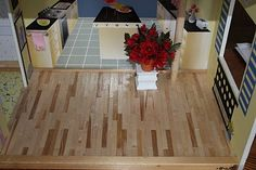 Barbie House remodel, she used popsicle sticks to make hard wood floors! Brilliant!