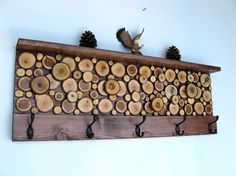 Rustic Wood Coat Rack with Shelf. I love the use of wood slices as interest, they would also make lovely coasters on their own.
