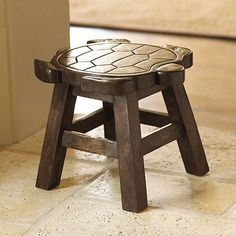 Turtle Stool from Ballard Designs  Hand carved from sturdy acacia wood with great natural details. Dark stained wood finish.