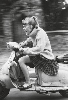 Woman riding scooter photo by Jean-François Jonvelle 1984
