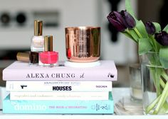Fashion books, nailpolish and a rose golden candle
