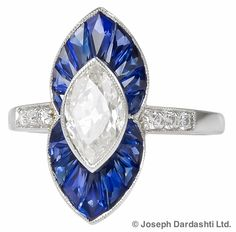 Marquise Diamond with Blue Sapphires in Platinum