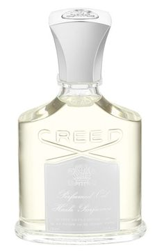 Creed 'Love In White'. The fresh, floral scent features notes of orange zest, rice husk, iris and magnolia.