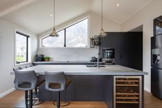 Dark kitchen with concrete look benchtops and architecural feature window Drinks Cabinet, Ceiling Beams, Man Cave, Concrete, New Homes, Window, Design Inspiration, Dark, Architecture