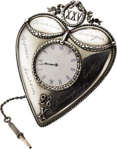 Rare Imperial Russian Fabergé Alexander III 25th Wedding Anniversary Presentation Desk Clock,  Workmaster Ivan Rappaport, St. Petersburg, circa 1891, signed IP, and Fabergé in Cyrillic, The heart-shaped silver clock engraved in Cyrillic script with the names of the Tsar's Imperial residences Gatchina, Livadia, Tsarskoe (Selo), Anichkov, Peterhof, and Cottage, the top applied with Roman numerals XXV within an openwork ribbon-tied laurelleaf wreath, the base, 28 X (October),