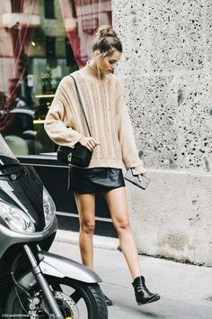 knit oversized sweater and leather mini skirt