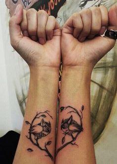 Owl on tree into heart tattoo