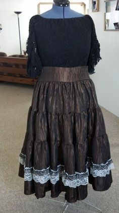 Chocolate brown, white lace with black and gold trim sold to a shooter in Kentucky