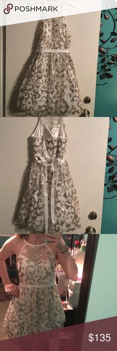 Homecoming or prom dress Gold and silver sequences light white dress with see through collar area. This dress hugs your rib area and it then flows out on the bottom WINDSOR Dresses Prom
