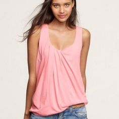 J.Crew draped tank NWOT A lovely new twist on the tank. Asymmetrical pleats lend a dressmaker's drape.  Perfect tank to match any outfit.  Dress up or dress down!  Pale pink color.  Meant to be a more flowy fit - can fit up to medium size J. Crew Tops Tank Tops