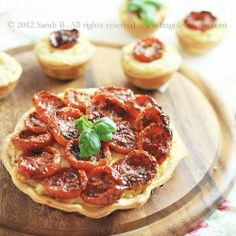Appetizer with oven tomatoes, feta cheese and potatoes.