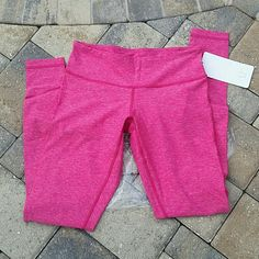 "Lululemon Wunder Under pant sz 8 NWT! Gorgeous heathered hot pink sz 8 Wunders. Ordered online but too long for me. Still have plastic bag they came in. They are luon (see tag on 2nd pic for description). Inseam is 30 1/2"". NO TRADES AND PRICE IS FIRM ON THIS ITEM. lululemon athletica Pants"