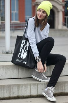 Striped shirt, grey sweatshirt, black pants, grey converse shoes, neon beanie